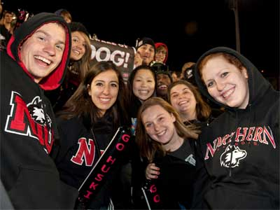 NIU students cheer on their football team during the 2011 Blackout game at Huskie Stadium. NIU beat Ball State that night in a 41-38 thriller to claim the Bronze Stalk.