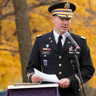 Lt. Col. David Dosier, professor of military science at NIU, speaks at the flagpole during the 2011 Veterans Day ceremony on campus.