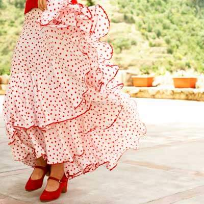 Photo of the flowing skirt and shoes of a flamenco dancer