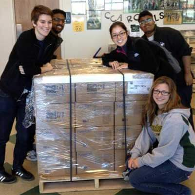 NIU students packed 3,000 pounds of food that would provide 2,307 meals to families around northern Illinois.