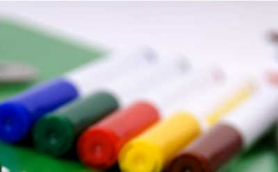 A photo of blue, green, red, yellow and brown markers