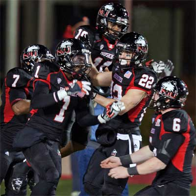 Huskies celebrate a Martel Moore touchdown vs. Toledo.