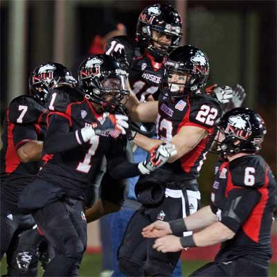 Huskies celebrate a Martel Moore touchdown vs. Toledo.