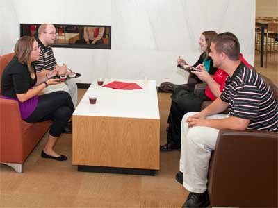 Students relax in the lounge of NIU's New Residence Hall.