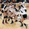 Go Huskies! NIU volleyball players surround Kayla Zeno (8) in celebration.