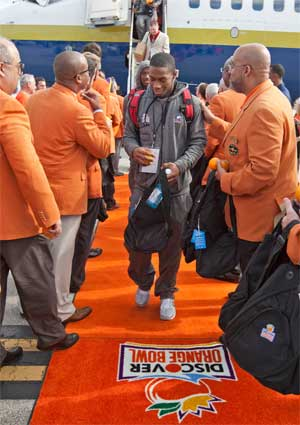 Perez Ashford walks the orange carpet in Miami.