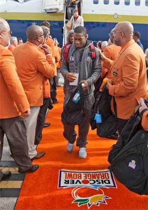 Perez Ashford walks the orange carpet in Miami.