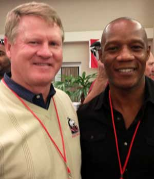 Former position coach Gary Evans chats with former NIU Huskie football player Earl Upton.