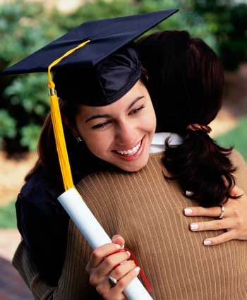 Photo of a graduate in cap and gown with diploma hugging mother