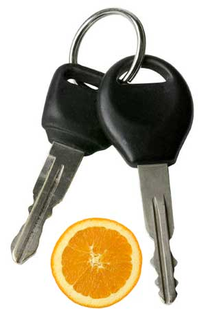 Image of car keys and an orange wedge