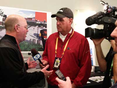 WGN-TV's Dan Roan interviews former Huskie football coach Jerry Kill.
