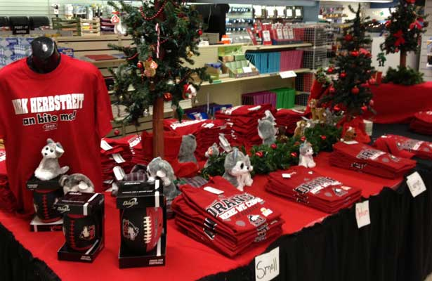 Photo of a Christmastime display of NIU Huskie gear at the University Bookstore.