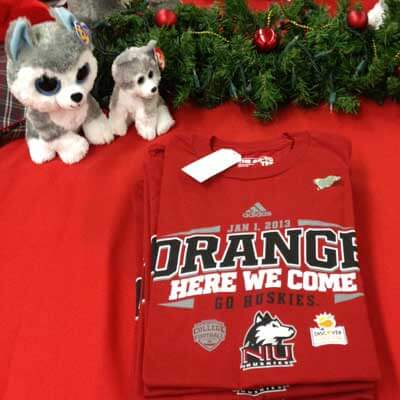 """Photo of an NIU """"ORANGE: HERE WE COME"""" T-shirt for sale at the University Bookstore."""