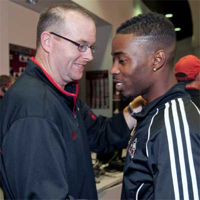 Rod Carey shakes hands with Martel Moore.