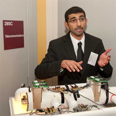 Abdullah Ahmad Alfehaid presents his work during the Fall 2011 Senior Design Day at the NIU College of Engineering and Engineering Technology.