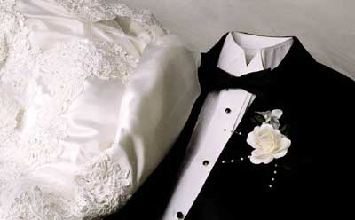 Photo of a bridal gown and tuxedo
