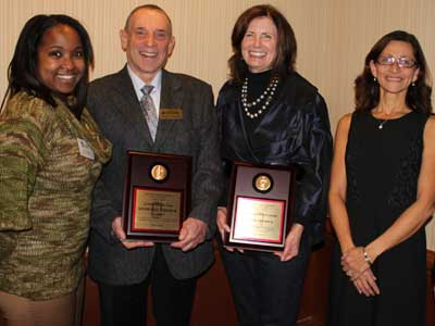 Kenneth and Ellen Chessick receive awards from the NIU College of Law. With them are Kenya Jenkins-Wright, left, president of the college's Alumni Council, and Dean Jennifer Rosato, right.
