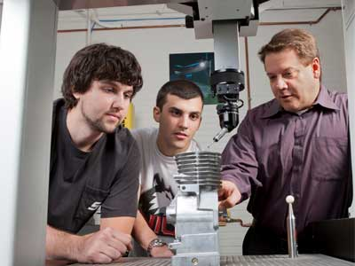 NIU Department of Technology professor David Schroeder works with students.
