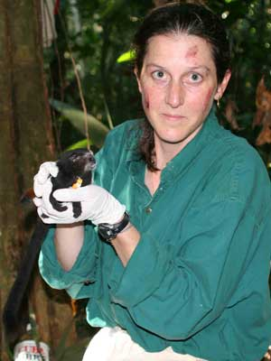 NIU anthropologist Leila Porter with a saddle-back tamarin.