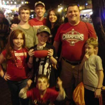 NIU alum and Huskie fan Boris Gorokhovsky (top right) joins family and friends to ring in 2013 at the Fort Lauderdale Downtown Countdown.