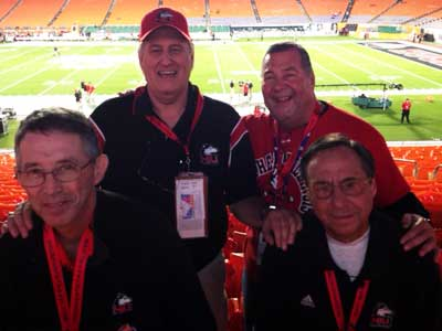 After 47 years of Huskie loyalty, NIU fans Mike Feinstein and Frank Olds (front) and Don Sitarz and Joe Holoubek (back) are cheering their team in a BCS bowl.