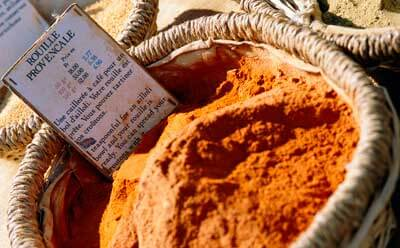 Photo of a basket of Rouille Provencale for sale at an open-air market in France.