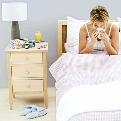 Photo of a woman sick in bed