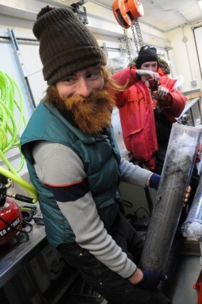 NIU Ph.D. student Timothy Hodson holds a core from the subglacial lake.