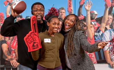 Students and their families can pose with a photograph of other  NIU Huskie football fans during Admitted Student Days, like this one in Decmeber of 2012.