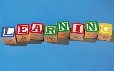 "The word ""learning"" spelled in alphabet blocks"