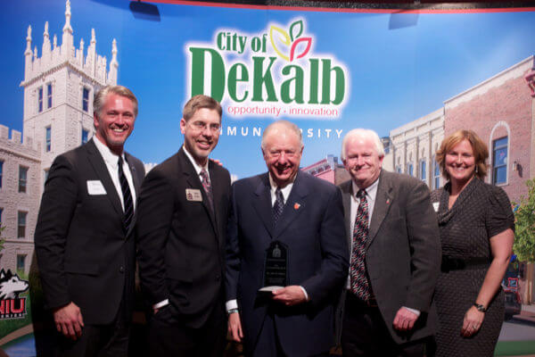 President John G. Peters (center) receives the Community Pride Award, flanked by (left to right) Mark Smirz, Matt Duffy, Bill Finucane and Wendy West-Krauch.