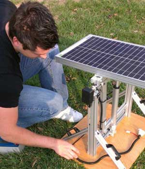 Photo of a student and a solar panel