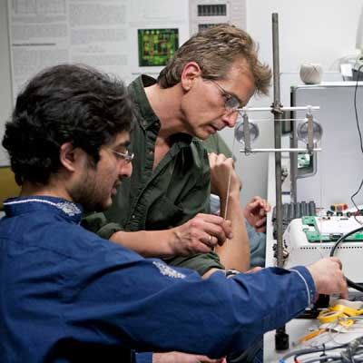 Photo of a student and professor working in a science lab