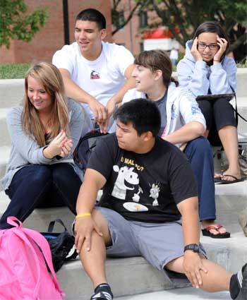 NIU students enjoy a fall day on campus.