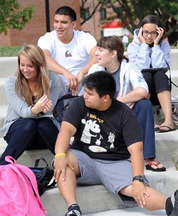 NIU students enjoy a fall day on campus.