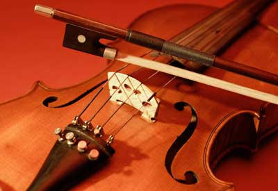 Photo of a violin and bow