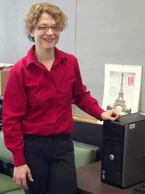 Cathy Doederlein stands in her Reavis Hall 306-A office.