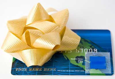 Photo of a credit card with a golden gift bow