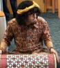 """A member of the NIU Gamelan Ensemble helps to break the """"quiet"""" rule inside the Rare Books Room of Founders Memorial Library."""