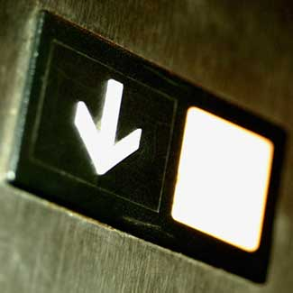 """Photo of an elevator's """"down"""" button"""