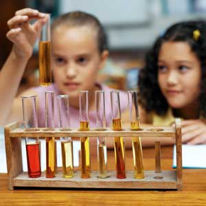 Photo of two girls working with test tubes