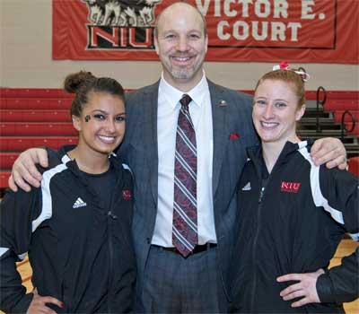 Coach Sam Morreale with seniors Marisa Liptak (left) and Natalie Sutter
