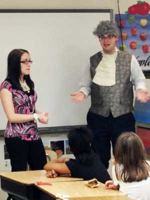 NIU students talk Monday to Tyler Elementary School fourth-graders about Money Smart Week.