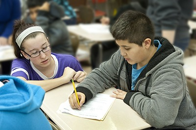 NIU student tutors middle school student