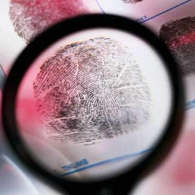 Photo of a fingerprint under a magnifying glass