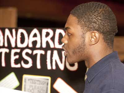 Photo of a student at a previous NIU Showcase of Student Writing