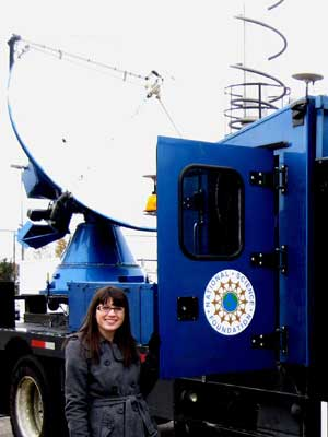 Wood stands next to the National Science Foundation's DOW (Doppler on Wheels) radar vehicle used for tornado research.