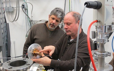 NIU Computer Science Chair Nicholas Karonis and Physics Chair Larry Lurio work together on an experiment at Argonne's Advanced Photon Source.