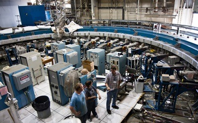 Physicists stand inside the Muon g-2 storage ring, in its current location at Brookhaven National Laboratory in New York. (Credit: Brookhaven National Laboratory)