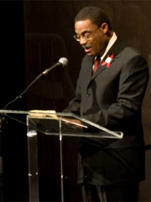 """Williams speaks and prays Feb. 14, 2009, during the """"Day of Reflection"""" ceremony in the NIU Convocation Center."""